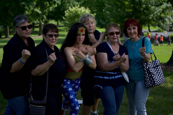 Wonder Woman joins forces with participants at the Chris Walk Night Out Against Substance Abuse July 15 at Mount St. Mary Park in St. Charles. Vicki Foley, Chris Foley's mother, is an employee of the Kane County Chronicle.