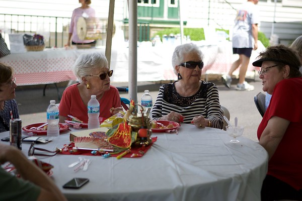 Janet Foster right President of Wilson Travel & Cruise visits with clients on July 15 at the 55th Anniversary cookout & ice cream social in St. Charles.