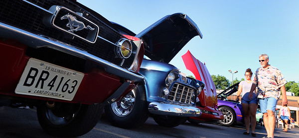 A Ford Mustang was among the vehicles during a Rock & Roll Roadshow cruise night at the A&W in North Aurora July 1.
