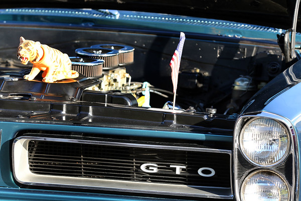 A Pontiac GTO was among the vehicles during a Rock & Roll Roadshow cruise night at the A&W in North Aurora July 1.