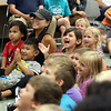 The audience reacts to the magic of Scott Green during a Summer Reading Ice Cream Social at the Geneva Public Library July 12.