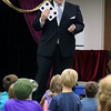 Scott Green shows the audience a card trick during a Summer Reading Ice Cream Social at the Geneva Public Library July 12.