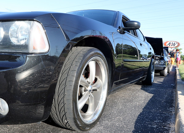 A Dodge Charger was among the vehicles during a Rock & Roll Roadshow cruise night at the A&W in North Aurora July 1.