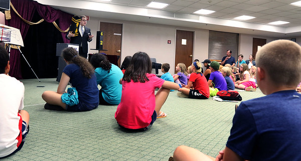 Scott Green performs magic during a Summer Reading Ice Cream Social at the Geneva Public Library July 12.