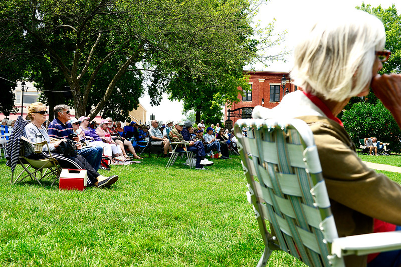 Kayla Wolf - for Shaw Media Woodstock Folk Festival attendees sprawl across the lawn Sunday, July 16, 2017 on the Historic Woodstock Square. The festival awarded a lifetime achievement award to Jacquie Manning and Rich Prezioso of the group Small Potatoes.