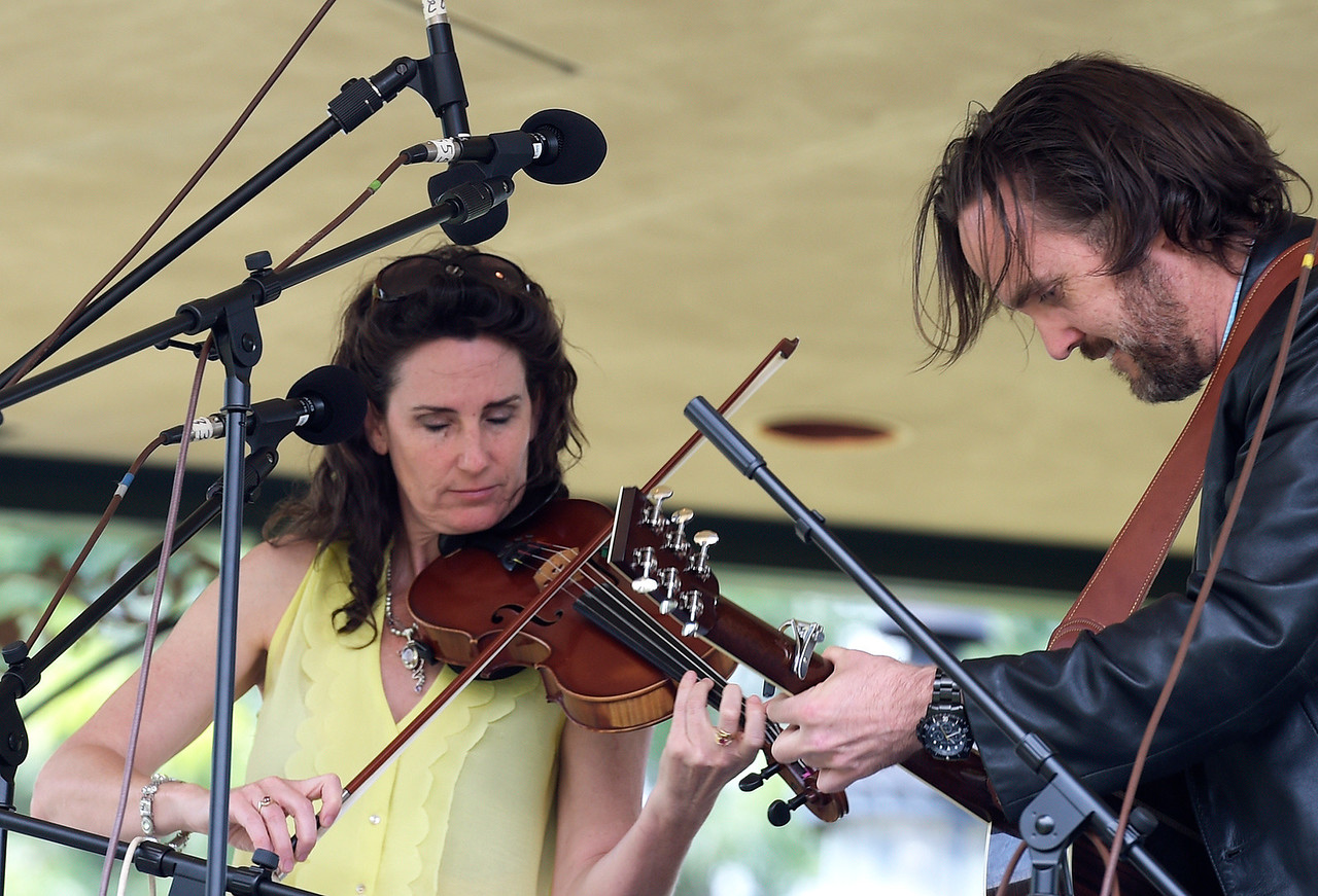 Kayla Wolf - for Shaw Media Stephanie Bettman plays the fiddle as Luke Halpin plays the guitar Sunday, July 16, 2017, at the Woodstock Folk Festival held on the Historic Woodstock Square. This was Woodstock Folk Festival's 32nd event.
