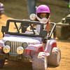 Lily Delao, 6, of Franklin Park eyes other drivers while competing in Kids Power Wheels Demo July 23 at the Kane County Fair in St. Charles. She won the event for the second straight year.