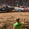 Flagger John Arndt of St. Charles looks on as Brad Ellingsworth, left, and Johnny Clemen tangle July 23 at the Kane County Fair in St. Charles.