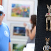 Unique rabbits hang at one of many vendors at the Geneva Art Fair along Third Street July 22.