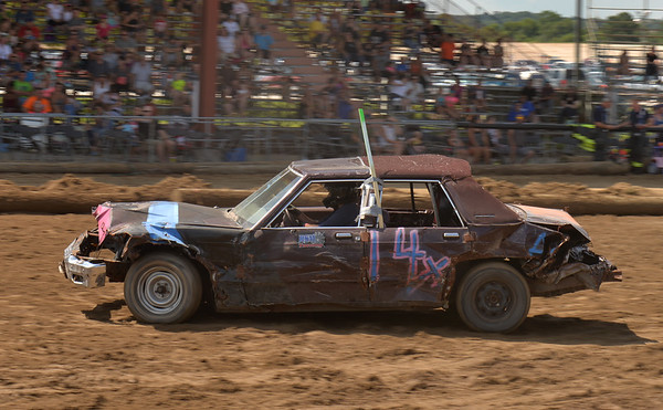 Matt Munsterman of Villa Park enters the stadium for a heat of Bone Stock Demolition Derby July 23 at the Kane County Fair in St. Charles.