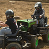 Eleven-year-old Dayden Charette of St. Charles bears down on 12-year-old competitor Brandon Ellingsworth of Bolingbrook July 23 in the lawn mower division of demolition derby at the Kane County Fair in St. Charles.