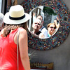 A mirror reflects patrons during the Geneva Art Fair along Third Street July 22.