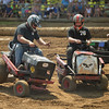 Brian Ellingsworth of Bolingbrook loses a tire on his lawn mower as Brad Ellingsworth of Bolingbrook avoids contact during demolition derby action July 23 at the Kane County Fair in St. Charles.