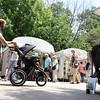 People stroll through the Geneva Art Fair along Third Street July 22.