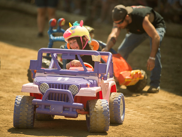 Phoenyx Vergara, 5, of Batavia giggles while competing in Kids Power Wheels Demo July 23 at the Kane County Fair in St. Charles.