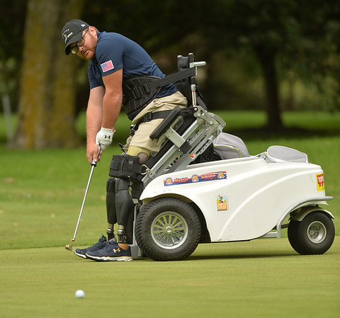 Veteran Matt Bowman of Lafayette, Indiana, watches his putt on the ninth green during a fundraiser for Warrior Wishes at Royal Hawk Country Club in St. Charles July 24. The non-profit  brings wounded veterans like Bowman to sporting events around the country.