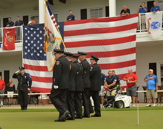 A police color guard marches to post the colors during ceremonies during the Warrior Wishes fundraiser at Royal Hawk Country Club in St. Charles July 24. Warrior Wishes  brings wounded veterans to ballgames and sporting events.