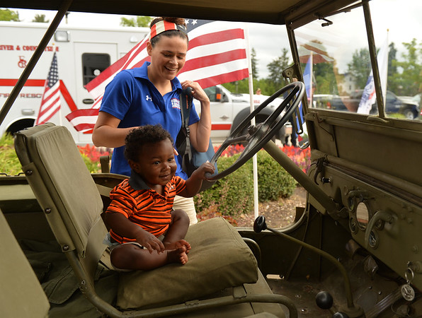 Henson Smith gets a good look inside an antique Willys military vehicle with his mother Tori Smith during a fundraiser for Warrior Wishes at Royal Hawk Country Club in St. Charles July 24. They made a trip from Tennessee with husband and father retired Army Sgt. Andrew Smith for the event. The event benefits the non-profit that brings veterans to sporting events.