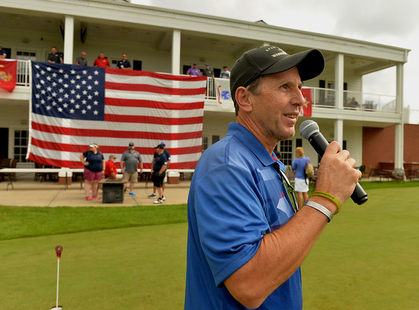Warrior Wishes founder Craig Stiecher of St. Charles makes announcements during a fundraiser at Royal Hawk Country Club in St. Charles July 24. The non-profit brings veterans to sporting events and games around the country.