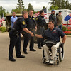 Special Forces veteran Anthony Netto of San Diego greets South Elgin police officers while arriving for a Warrior Wishes fundraiser at Royal Hawk Country Club in St. Charles July 24. The event benefits Operation Warrior Wishes, a non-profit that brings veterans to sporting events.