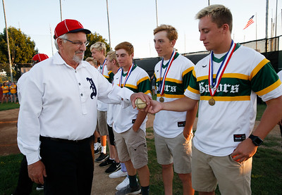 "A member of the Independents, a Civil War era baseball team from the McHenry County Historical Society shows a ""lemon ball"" to Michael Swiatly with the Crystal Lake South baseball team during the MCYSA international baseball tournament's opening ceremony at Lippold Park on Thursday, July 27, 2017 in Crystal Lake, Illinois. The Crystal Lake South baseball team was honored for their IHSA Class 4A Championship during the ceremony. John Konstantaras photo for the Northwest Herald"