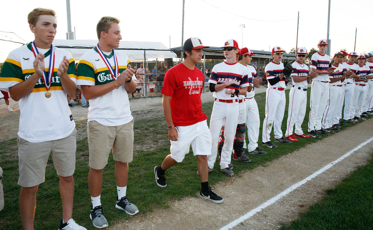 Kankakee Community College baseball player Daniel Tenayuca, from Lake in the Hills, is honored with Nick Albanese (not pictured) for their NJCAA Division 2 World Series Championship during the MCYSA international baseball tournament's opening ceremony at Lippold Park on Thursday, July 27, 2017 in Crystal Lake, Illinois. John Konstantaras photo for the Northwest Herald