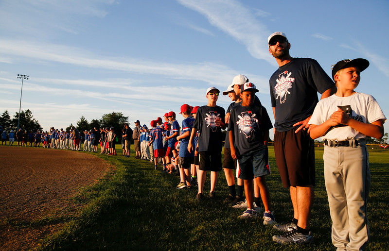 McHenry County Baseball League All-Stars line up on the first during introductions of the team at the MCYSA international baseball tournament's opening ceremony at Lippold Park on Thursday, July 27, 2017 in Crystal Lake, Illinois. John Konstantaras photo for the Northwest Herald