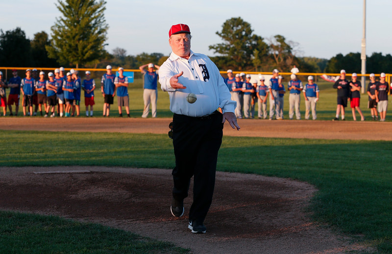 In a Civil War era uniform Jeff Purcell, from Marengo with the McHenry County Historical Society, throws out the ceremonial first pitch during the MCYSA international baseball tournament's opening ceremony at Lippold Park on Thursday, July 27, 2017 in Crystal Lake, Illinois. John Konstantaras photo for the Northwest Herald