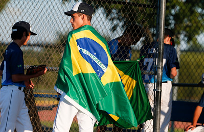Gabriel Higashi, with the Brazilian baseball team wears his country flag as a cape before the MCYSA international baseball tournament's opening ceremony at Lippold Park on Thursday, July 27, 2017 in Crystal Lake, Illinois. John Konstantaras photo for the Northwest Herald