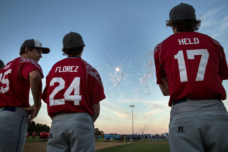 Players from the Crystal Lake Babe Ruth team watch fireworks during the MCYSA international baseball tournament's opening ceremony at Lippold Park on Thursday, July 27, 2017 in Crystal Lake, Illinois. John Konstantaras photo for the Northwest Herald
