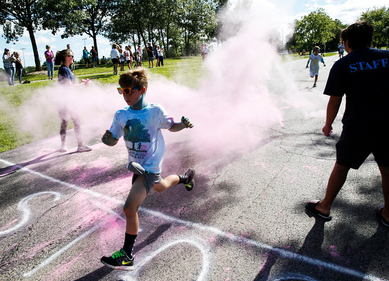 Spike Boyd, 10 from Cary crosses the finish line during the Cary Park District 5K Color Run on Saturday, July 29, 2017 in Cary, Illinois. John Konstantaras photo for the Northwest Herald