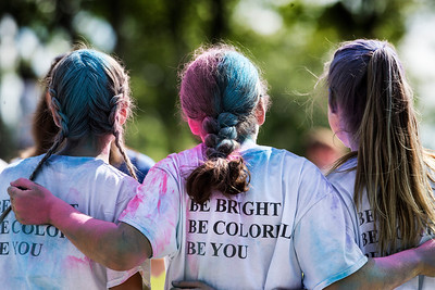 Finishers pose of a photo after the Cary Park District 5K Color Run on Saturday, July 29, 2017 in Cary, Illinois. John Konstantaras photo for the Northwest Herald