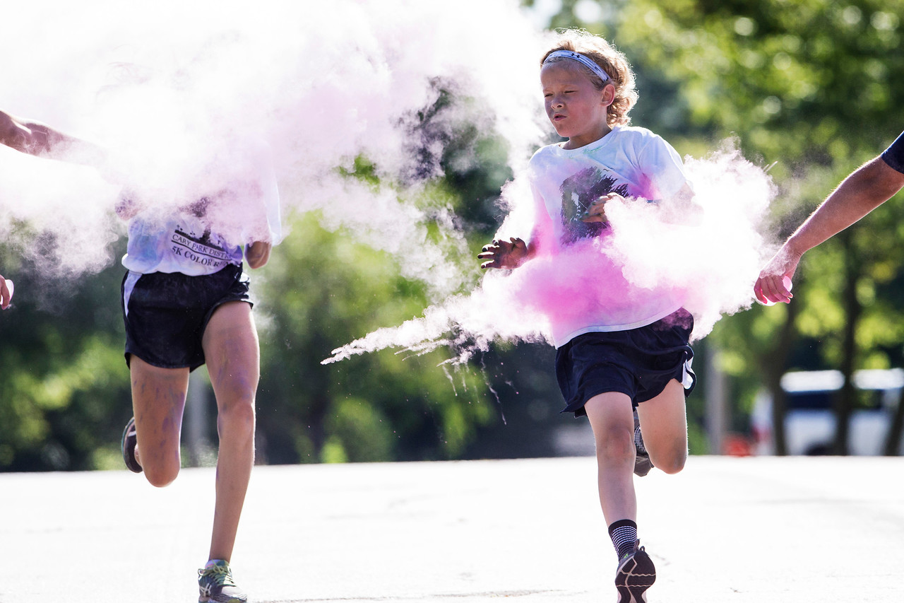 Ian Frangiamore, right, 11, and Ada Saletnik, 12, both from Cary are hit with pink powder as they cross the finish line during the Cary Park District 5K Color Run on Saturday, July 29, 2017 in Cary, Illinois. John Konstantaras photo for the Northwest Herald