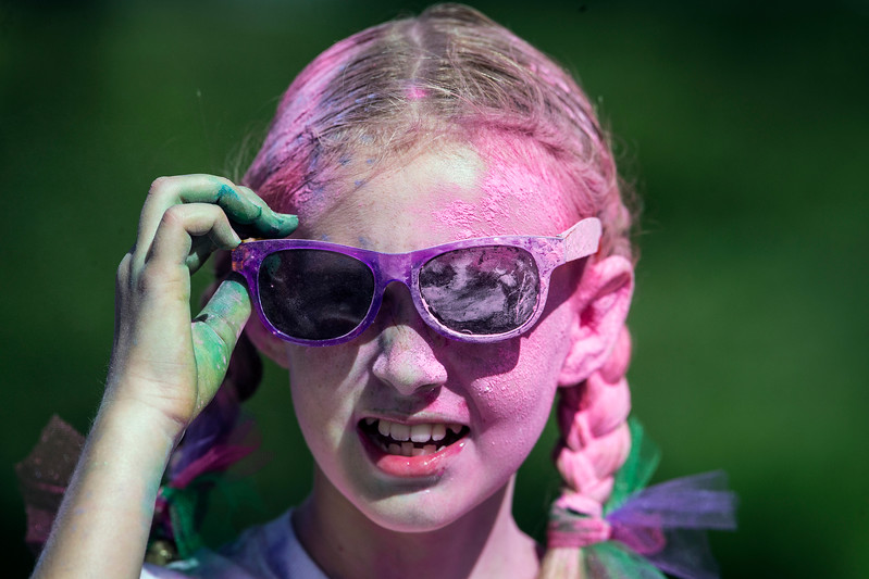 Keaton Murdock, 10 from Cary, wears her color after the Cary Park District 5K Color Run on Saturday, July 29, 2017 in Cary, Illinois. John Konstantaras photo for the Northwest Herald