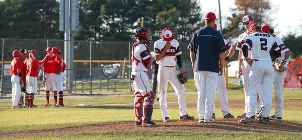 The Crystal Lake Cardinals have a meeting on the mound in the seventh inning of their 15u championship game during the MCYSA International Baseball Tournament at Lippold Park on Sunday, July 30, 2017 in Crystal Lake, Illinois. Elite Baseball Training defeated the Crystal Lake Cardinals 6-5. John Konstantaras photo for the Northwest Herald