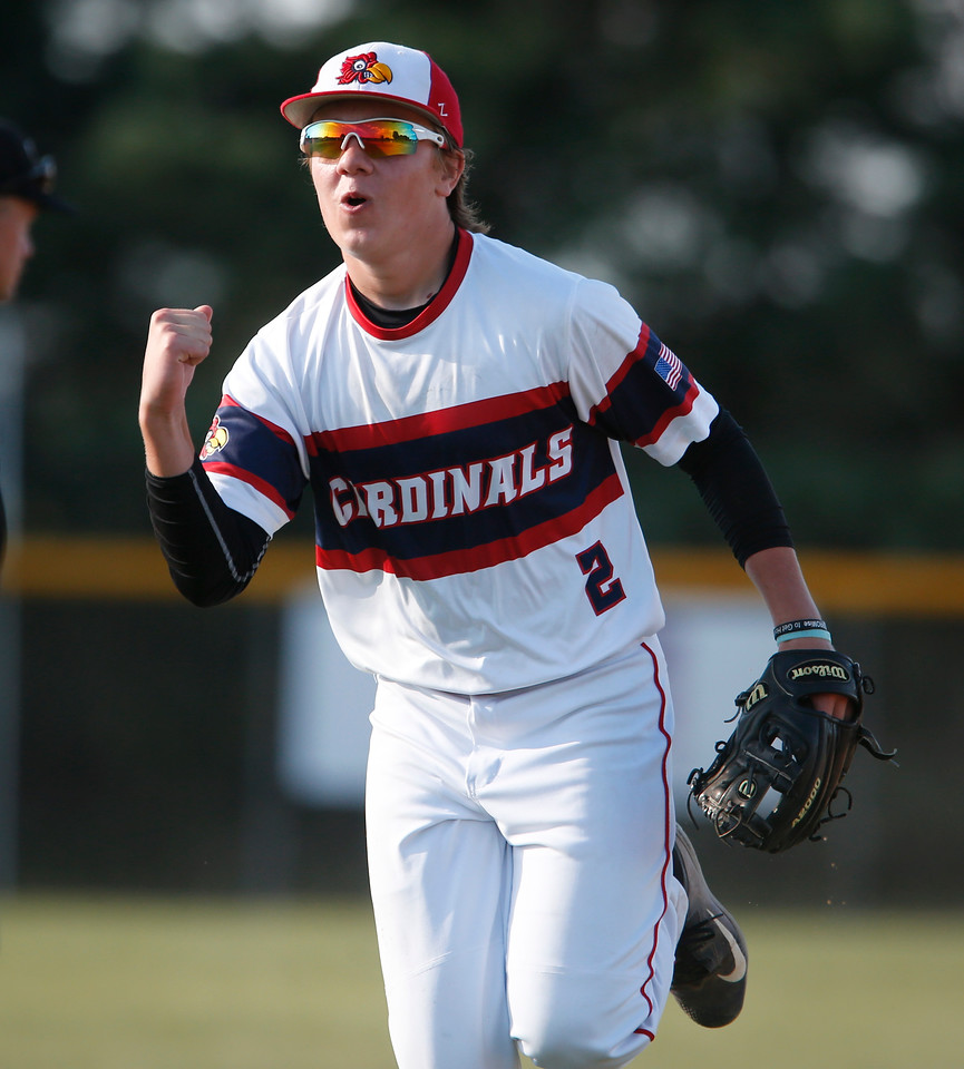 Crystal Lake Cardinals' Carter Spoden (2) pumps his fist after completing a double play to end the fifth inning during their 15u championship game against Elite Baseball Training during the MCYSA International Baseball Tournament at Lippold Park on Sunday, July 30, 2017 in Crystal Lake, Illinois. Elite Baseball Training defeated the Crystal Lake Cardinals 6-5. John Konstantaras photo for the Northwest Herald