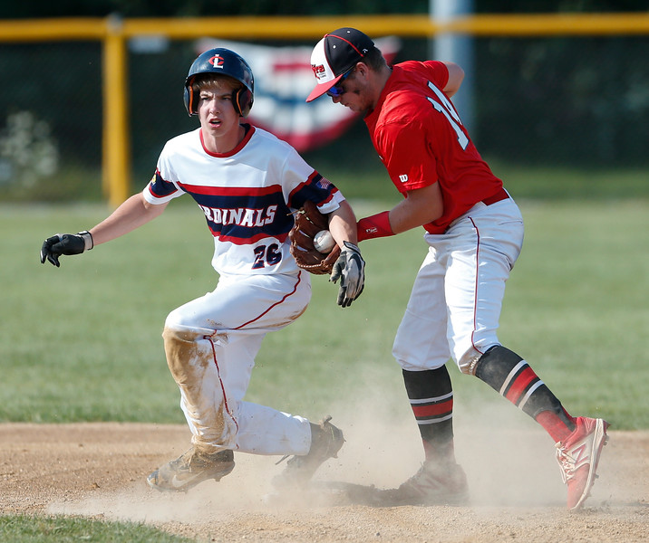 Crystal Lake Cardinals' Jake Skirpan (26) steals second base on Elite Baseball Training's David Sharp (14) during the first inning of their 15u championship game during the MCYSA International Baseball Tournament at Lippold Park on Sunday, July 30, 2017 in Crystal Lake, Illinois. Elite Baseball Training defeated the Crystal Lake Cardinals 6-5. John Konstantaras photo for the Northwest Herald