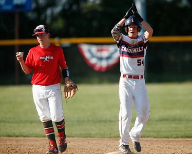 Elite Baseball Training's Noah Burgh (13) hold the ball as Crystal Lake Cardinals' Kyle Green (54) celebrates his leadoff double to start the seventh inning during their 15u championship game during the MCYSA International Baseball Tournament at Lippold Park on Sunday, July 30, 2017 in Crystal Lake, Illinois. Elite Baseball Training defeated the Crystal Lake Cardinals 6-5. John Konstantaras photo for the Northwest Herald