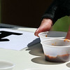 A cup of chili is taken from vendor #16 during the 25th annual Illinois State Championship Chili Cook-Off hosted by the Batavia Park District and Batavia Chamber of Commerce at the Batavia Riverwalk July 29.