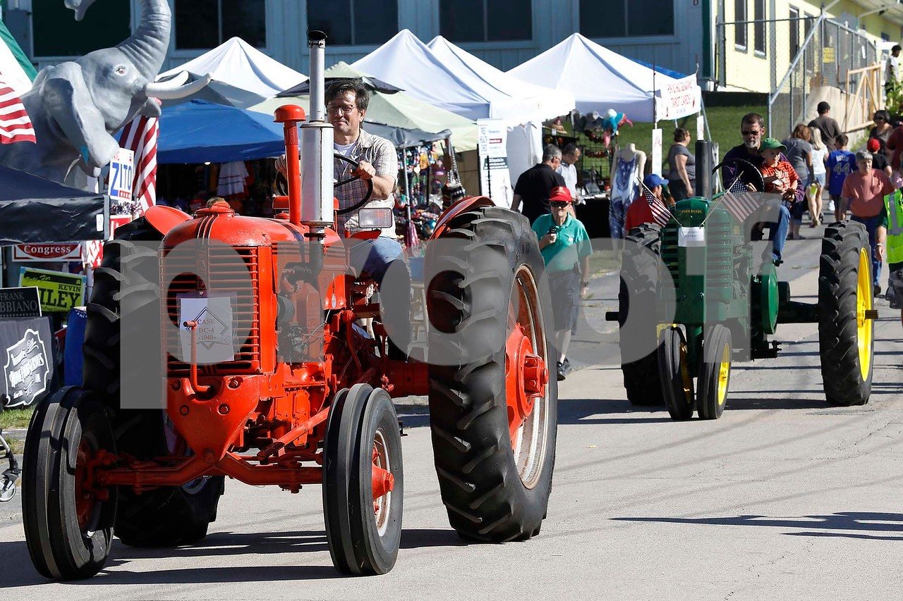An antique tractor parade was part of the DuPage County Fair on Saturday, July 29, 2017. Sarah Minor for Shaw Media