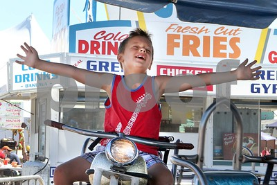 Lawton Konecny, 6, of Chicago enjoys the rides Saturday, July 29, 2017 at the DuPage County Fair. Sarah Minor for Shaw Media