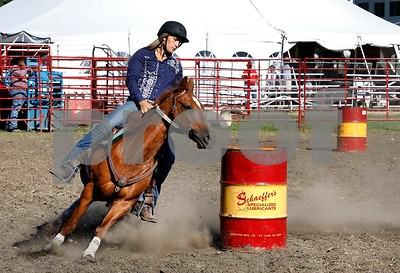 Jessica McCall of Wayne competes in barrel racing Saturday, July 29, 2017 in the rodeo at the DuPage Coutny Fair. Sarah Minor for Shaw Media