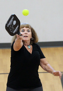 Candace H. Johnson-For Shaw Media Donna Sheppard, of Antioch reaches high for the shot as she plays pickleball at Lakefront Park in Fox Lake. Pickleball is offered Monday & Wednesday 1-4:30 pm and Thursday 6-7:30 pm at Lakefront Park.(7/2/18)