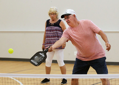 Candace H. Johnson-For Shaw Media Marlyce Homan, of Antioch watches Bob Fenrich, of Fox Lake take a shot near the net as they play pickleball at Lakefront Park in Fox Lake. Pickleball is offered Mondays & Wednesday 1-4:30 pm and Thursday 6-7:30 pm. at Lakefront Park.(7/2/18)