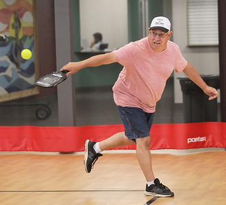 Candace H. Johnson-For Shaw Media Bob Fenrich, of Fox Lake hits the ball using a paddle as he plays pickleball at Lakefront Park in Fox Lake. Pickleball is offered Monday & Wednesday 1-4:30 pm and Thursday 6-7:30 pm at Lakefront Park.(7/2/18)