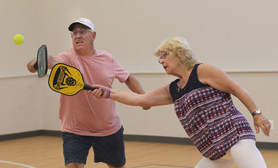 Candace H. Johnson-For Shaw Media Bob Fenrich, of Fox Lake and Marlyce Homan, of Antioch go for the ball as they volley while playing pickleball at Lakefront Park in Fox Lake. Pickleball is offered Monday & Wednesday 1-4:30 pm and Thursday 6-7:30 pm at Lakefront Park.(7/2/18)