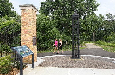 Candace H. Johnson-For Shaw Media Tracy Link, of Spartanburg, S.C., walks with Sally Shineflug, of Highland Park walk past the upgraded Gate Exhibit at the Fort Sheridan Forest Preserve. Fort Sheridan was built in 1887.(7/9/18)