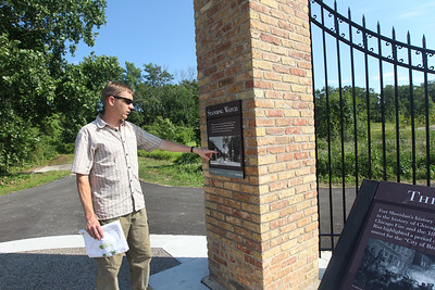 Candace H. Johnson-For Shaw Media Michael Haug, of Libertyville, landscape architect and construction project manager, with the Lake County Forest Preserves points to the history of the iron gate as part of the upgraded Gate Exhibit at the Fort Sheridan Forest Preserve.(7/9/18)