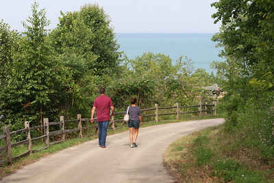 Candace H. Johnson-For Shaw Media Kevin Tajer, of Arlington Heights and his mother, Catherine Dopak, of Wauconda walk on the Hutchinson Trail which goes from Sheridan Road to the lakefront at the Fort Sheridan Forest Preserve.(7/9/18)