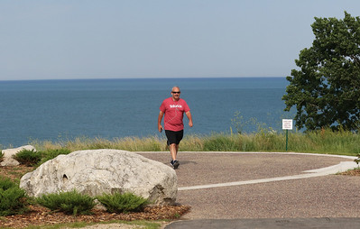 Candace H. Johnson-For Shaw Media Paul Davidson, of Highland Park takes a walk on the Lake Overlook as part of the public access improvement project at the Fort Sheridan Forest Preserve.(7/9/18)